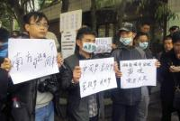 Manifestantes piden libertad de expresión en Cantón, el 8 de enero