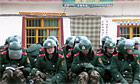 Security forces sitting - The Guardian